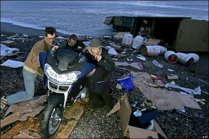 Salvors taking a BMW motorcycle from the Napoli's cargo.