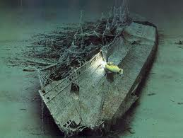 This is a saltwater shipwreck. Notice how the metal has given way and caved in upon itself. Also look how the saltwater currents have strewn the ship's components to the side.