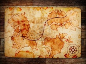 12691859-old-treasure-map-on-wooden-background-e1371849072992