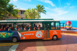 trolley driving by Key West Southernmost Buoy